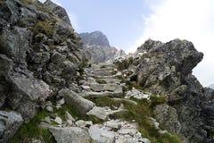 Red marked mountain trail in Tatra Mountains. Red marked mountain trail. Stone stairs in difficult rocky terrain. Tatra Mountains. Slovakia stock photo