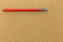 Red marker on cork board Stock Image