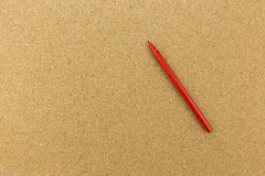 Red marker on cork board Royalty Free Stock Images