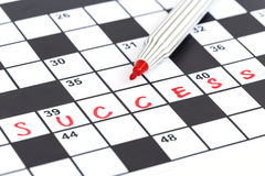Red marker on Crossword - Success. Close up red marker on Crossword - Success Stock Photos