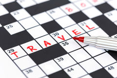 Red marker on Crossword - Travel. Close up red marker on Crossword - Travel Stock Images