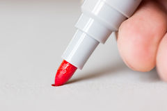 Red marker draws a line Stock Images