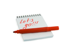 Red marker and notebook Stock Images