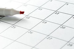 Red marker pen and calendar Stock Photo
