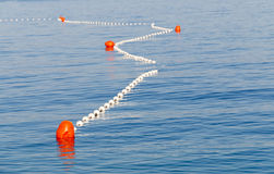 Red markers in the sea marking the safe swimming area Stock Images