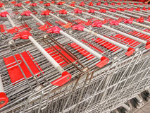 Red market trolleys for shopping Stock Images