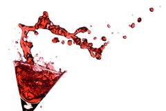 Red Martini. Being poured in a martini glass; isolated on a white background Royalty Free Stock Images