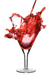 Red martini. Being poured in a glass; isolated on a white background Stock Photography