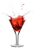 Red martini. Being poured in a glass; isolated on a white background Royalty Free Stock Photos