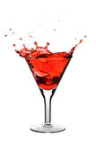 Red martini. Being poured in a glass; isolated on a white background Stock Photo
