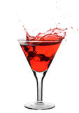 Red martini. Being poured in a glass; isolated on a white background Stock Images