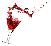 Red Martini. Being poured in a martini glass; isolated on a white background Royalty Free Stock Image
