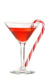 Red martini with a candy cane. Isolated red martini with a candy cane on white background Stock Photography