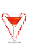 Red martini with candy canes. Isolated red martini with candy canes on white background Stock Image