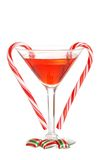 Red martini with christmas candies. Isolated red martini with christmas candies on white background Stock Photo