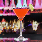 Red Martini Cocktail drink in a bar or disco. Red Martini Cocktail drink in a glass in a bar or a disco Stock Image