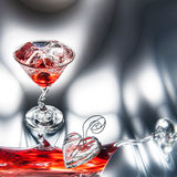Red Martini (cocktail) with ice cubes Stock Image