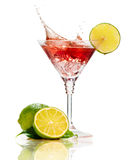 Red martini cocktail with splash and lime. On white Royalty Free Stock Photos