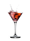 Red martini cocktail splashing in glass isolated. On white Stock Photos