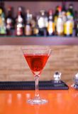 Red martini drink cocktail in a bar royalty free stock image