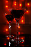 Red martini glass. Pair of martini glass on red abstract background stock photo