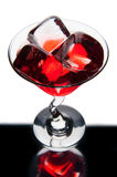 Red martini glass with ice cubes Stock Photo