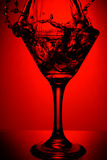 Red martini splash Stock Photo