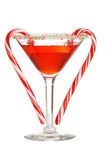 Red martini with two candy canes. Isolated red martini with two candy canes on white background Royalty Free Stock Photography