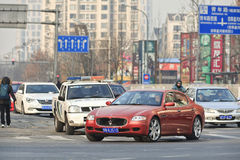 Red Maserati Quatroporte on the street, Beijing, China royalty free stock photo