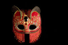 Red Mask. A red velvet cat eared mask with embroidered detail Royalty Free Stock Photo