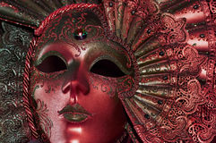 Red mask. Celebratory dark red mask with a jewel Royalty Free Stock Photos