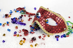 Red Mask for Celebrations. Red Mask white snow and confetti for Parties and Celebrations stock photos