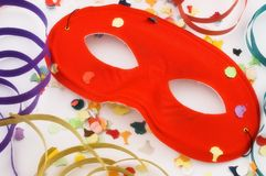 Red mask with confetti and streamers Royalty Free Stock Photography