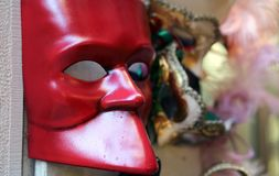 Red mask for sale in calle of Venice Stock Image
