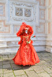 Red mask and venetian architecture Stock Photos