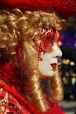 Red mask and wig, Venice, Italy, Europe Royalty Free Stock Photo