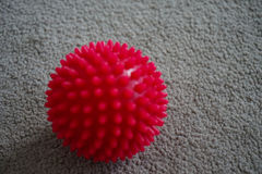 Red massage ball with spikes royalty free stock photography