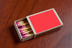 Red Match box. On wooden table Stock Image