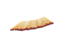 Red match and wooden stick on white background Stock Photo
