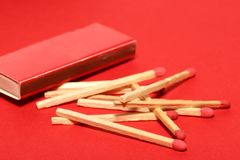 Red matches with box on red Stock Images