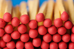 Red matchsticks on blue background Royalty Free Stock Images