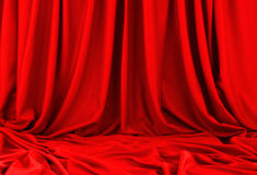 Red material. Red silk material with folds Royalty Free Stock Photos