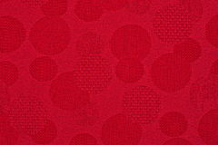 Red material in circles, a background Stock Image