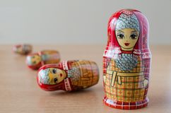 Red matryoshka. Blurred background. Close-up royalty free stock photography