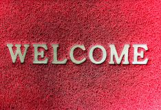 Red mats with welcome word. Closeup red mats with welcome word stock photo