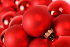 Red matt christmas ball on background of group red christmas balls Stock Photos