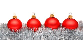 Red matt christmas balls on tinsel Royalty Free Stock Photo