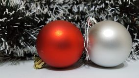Red matte christmas ball decoration with a silver ball decoration Stock Photos