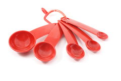 Red Measurement spoons. On a white background Royalty Free Stock Photography