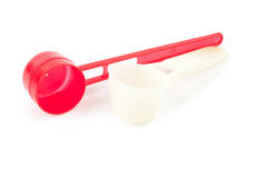 Red measuring spoon Royalty Free Stock Image